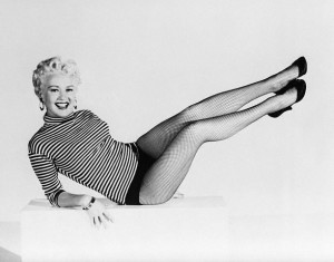 """16 Aug 1954, Hollywood, Los Angeles, California, USA --- 8/16/1954-Hollywood, CA- Pin-up queen Betty Grable kicks up her heels in a scene from """"Three for the Show."""" She's back in a dancing role in the movie after letting her famous legs rest in several films. --- Image by © Bettmann/CORBIS"""